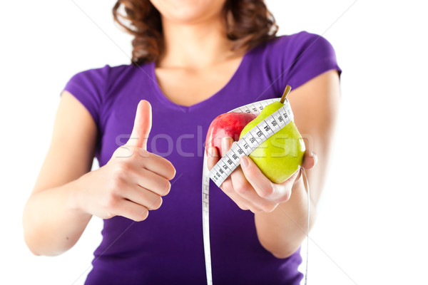 Woman with apple, pear and measuring tape Stock photo © Kzenon