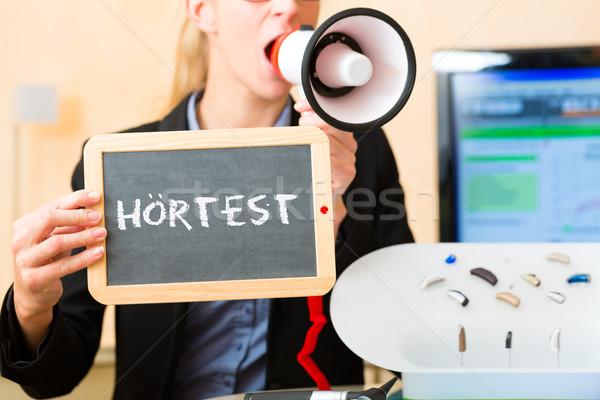 Woman advertising a hearing test Stock photo © Kzenon