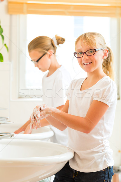 Girls are washing hands in the bath Stock photo © Kzenon