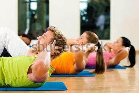 Sexy baisser Retour gymnastique couple gymnase Photo stock © Kzenon