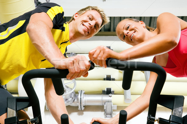 Bicycle spinning in the gym Stock photo © Kzenon