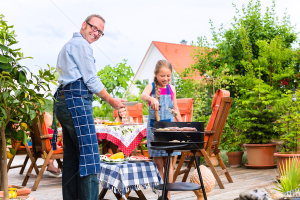 Barbecue with family in the garden Stock photo © Kzenon