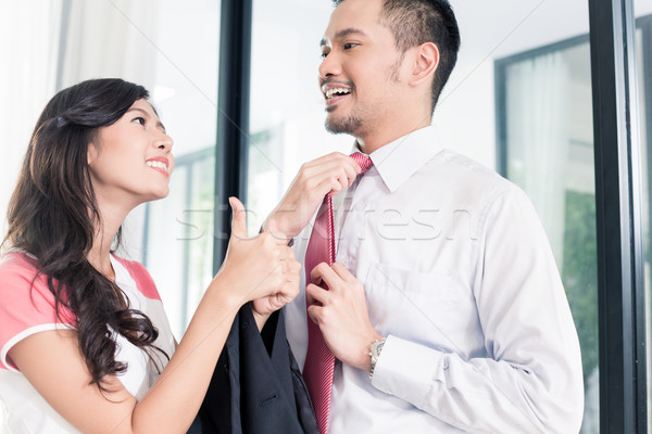 Wife helping her man going to office for work Stock photo © Kzenon