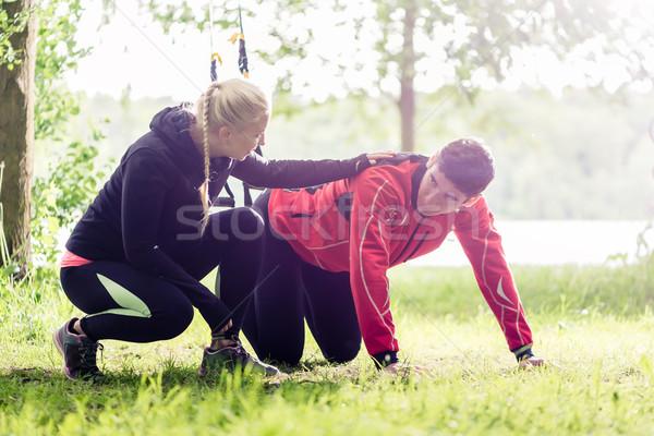 Sport pár kint csúzli edző nő Stock fotó © Kzenon