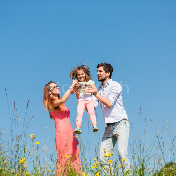 Stock photo: Family of mother, father and child on meadow