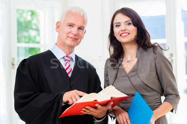 Lawyer and paralegal in their law office Stock photo © Kzenon