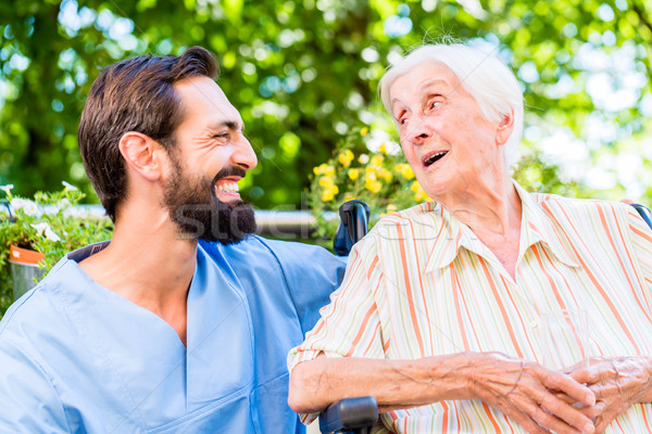 Nurse having chat with senior woman in nursing home Stock photo © Kzenon