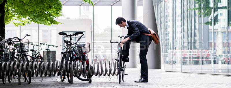 Businessman parking his bicycle in town Stock photo © Kzenon