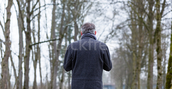 Sad and lonely man walking in winter landscape Stock photo © Kzenon