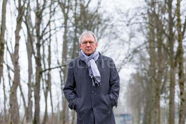 Lehangolt szomorú férfi sétál tél egyedül Stock fotó © Kzenon
