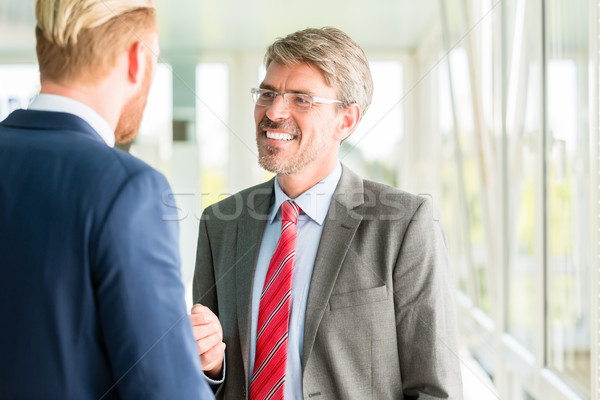 Business partners having a conversation Stock photo © Kzenon