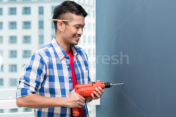 азиатских мастер на все руки бурение стены небоскреба здании Сток-фото © Kzenon