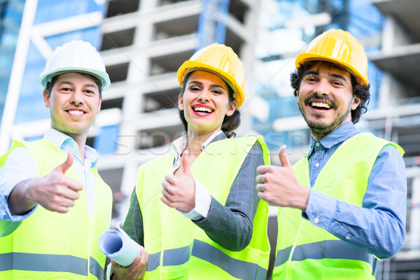 Team of civil engineers and architects at construction  Stock photo © Kzenon