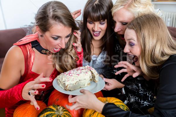 Four women wearing Halloween costumes while posing funny before  Stock photo © Kzenon