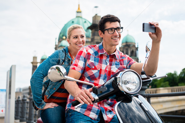 Scooter riding tourists taking selfie in front of Berlin Cathedr Stock photo © Kzenon