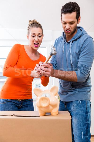 Couple moving house needing money Stock photo © Kzenon