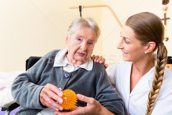 Enfermeira fisioterapia senior mulher massagem bola Foto stock © Kzenon