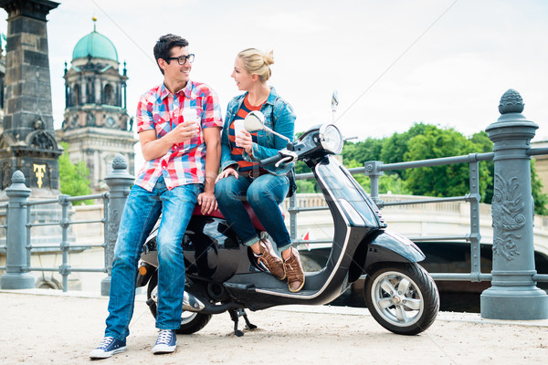 Scooter riding tourists drinking coffee in Berlin Stock photo © Kzenon