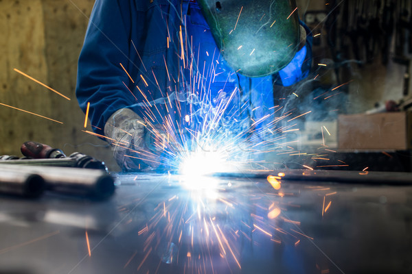 Welder in his workshop welding metal Stock photo © Kzenon
