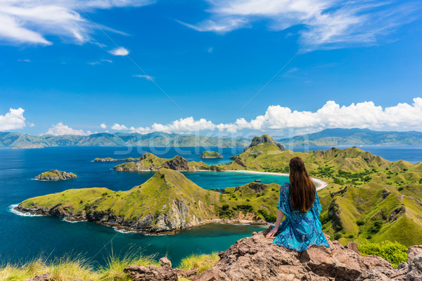 Young woman enjoying the awesome view of Padar Island during summer vacation Stock photo © Kzenon