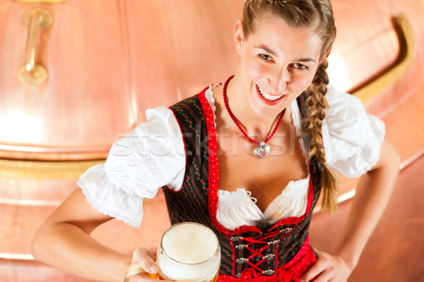Woman with beer glass in brewery Stock photo © Kzenon