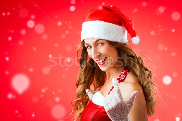 Attractive young woman in Santa Claus costume alluring gesture Stock photo © Kzenon