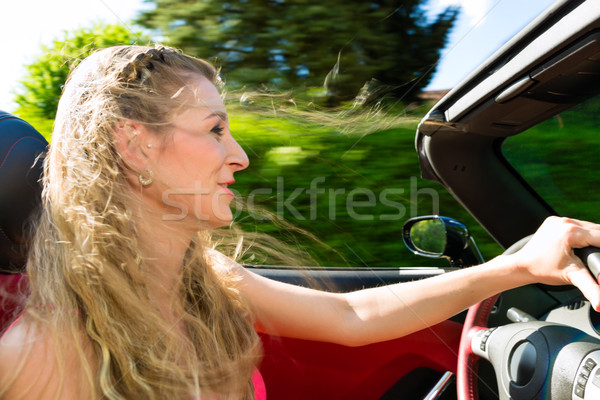 Young woman with cabriolet in summer on day trip Stock photo © Kzenon