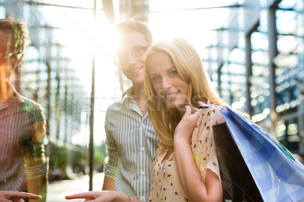 Couple while shopping and spending money Stock photo © Kzenon
