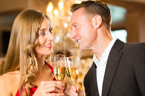 Stock photo: Man and woman tasting Champagne in restaurant