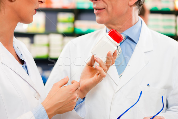 Two pharmacists in pharmacy consulting Stock photo © Kzenon