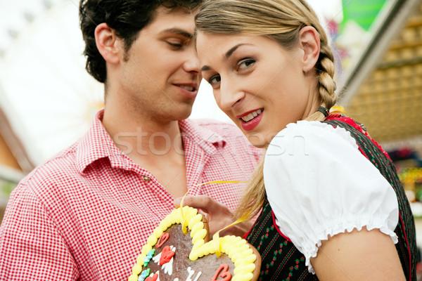 Couple with gingerbread heart Stock photo © Kzenon