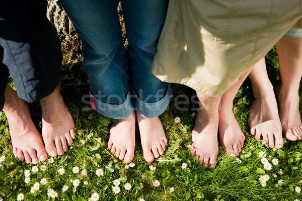 Egészséges láb csetepaté férfiak nők különböző Stock fotó © Kzenon