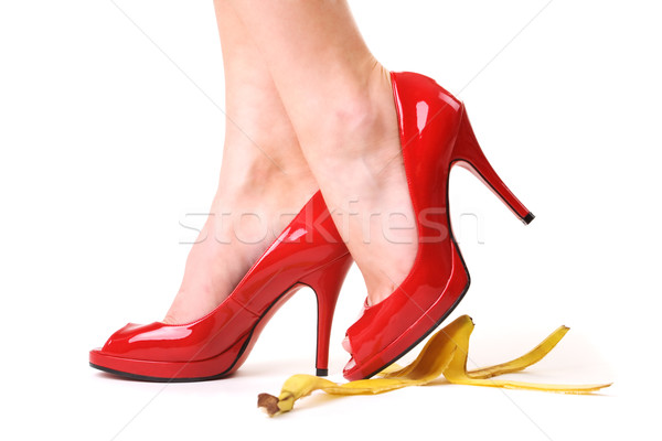high heels over bananapeel Stock photo © Kzenon