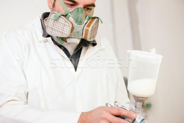 Pintor de trabajo pintura en aerosol hombre pintura industria Foto stock © Kzenon