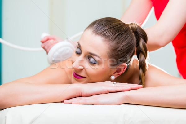 Woman having back massage in wellness spa Stock photo © Kzenon