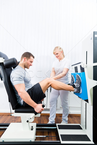 Physiotherapist exercising patient in sport therapy Stock photo © Kzenon