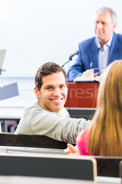 Stock photo: College professor giving lecture for students