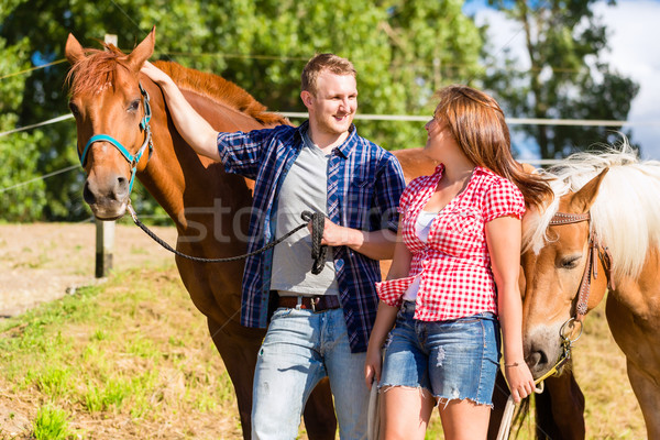 Pár ló póni istálló nő férfi Stock fotó © Kzenon