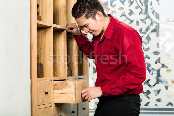 Korean man shopping cabinet in furniture store Stock photo © Kzenon
