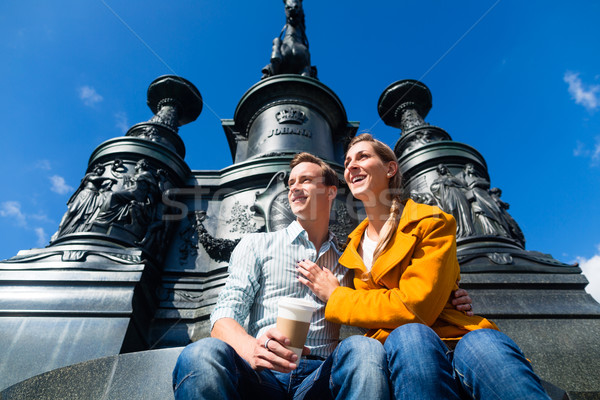 Couple sitting in Dresden Theaterplatz on statue Stock photo © Kzenon