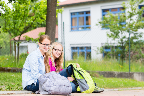 Two students sitting at school in recess Stock photo © Kzenon