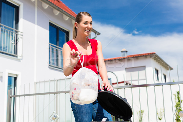 Woman throwing the garbage away in container Stock photo © Kzenon
