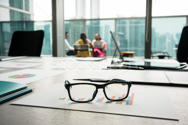 Close-up of eyeglasses on a printed bar chart showing progress Stock photo © Kzenon