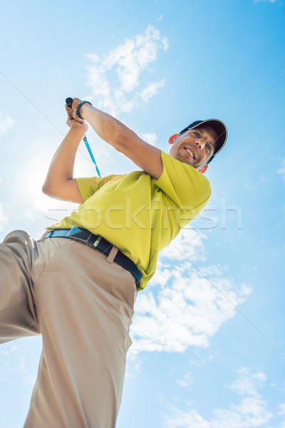Stock photo: Low-angle view of a professional player holding the club during