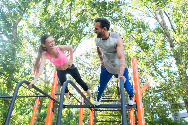 Young fit woman and her partner practicing plank exercise during Stock photo © Kzenon
