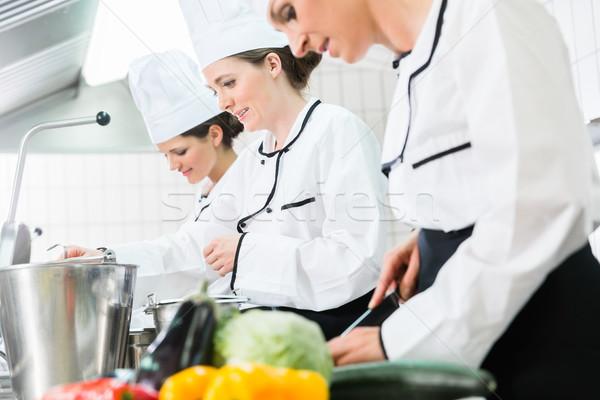 chefs preparing meals in commercial kitchen Stock photo © Kzenon