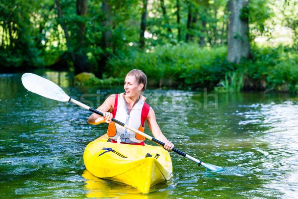 Femme canot forêt rivière été sport Photo stock © Kzenon