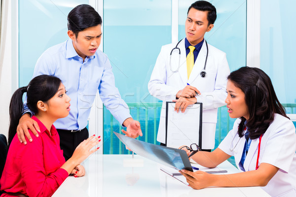 ázsiai beteg konzultáció orvos iroda tanács Stock fotó © Kzenon