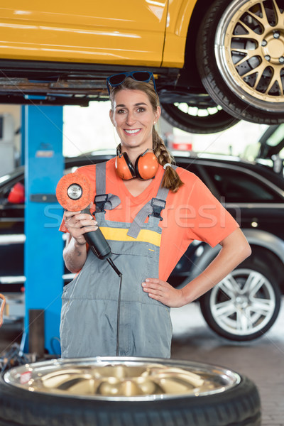 Portrait of a cheerful female auto mechanic wearing safety equipment Stock photo © Kzenon