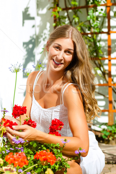 Woman gardener looking after flowers  Stock photo © Kzenon